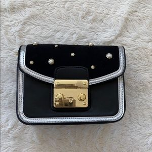 """Brand new black and """"jeweled"""" clutch with strap"""